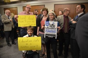A number of school board members attended Monday's press conference.