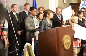 Parents United for Public Schools' Ann Hobbie opened Monday's press conference.